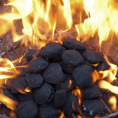 burning charcoal in an outdoor grill