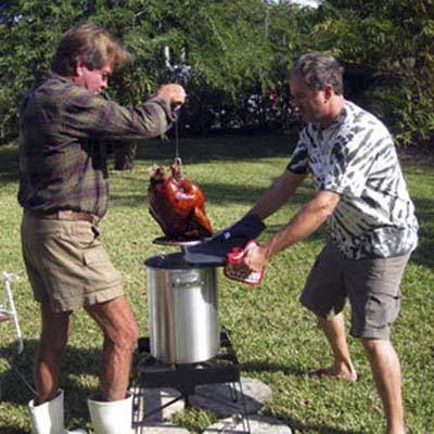 two men using a turkey fryer