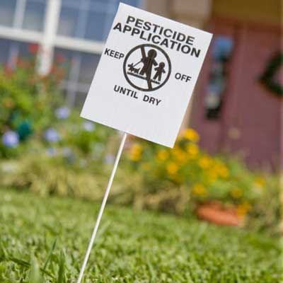 lawn with pesticide warning sign