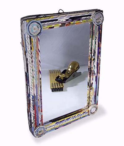 mirror framed in recycled magazines