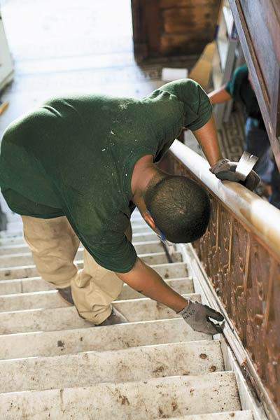 removing wood beneath iron staircase