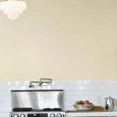 salvaged white tile for backsplash in sustainable home's kitchen