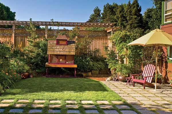 Sustainable Backyard Ideas : sustainable garden outdoor aviary Carlson built from salvaged