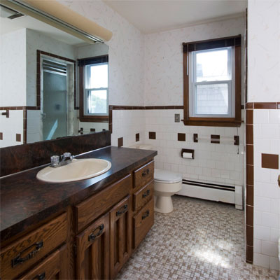a full bathroom will be cut down by half at this waterfront barrington rhode island beach house