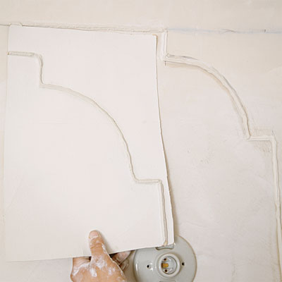 comparing new plaster detail to old during the toh tv los angeles house project remodel