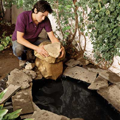 Mark Powers installing a backyard pond