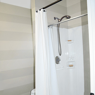 Shower Stall In Remodeled Bathroom With White Waffle Curtain And
