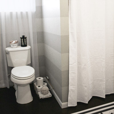 finished bathroom with striped walls