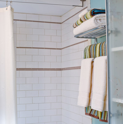 remodeled bathroom with smart storage towel racks
