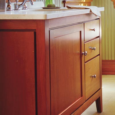 craftsman style bathroom with warm wood accents