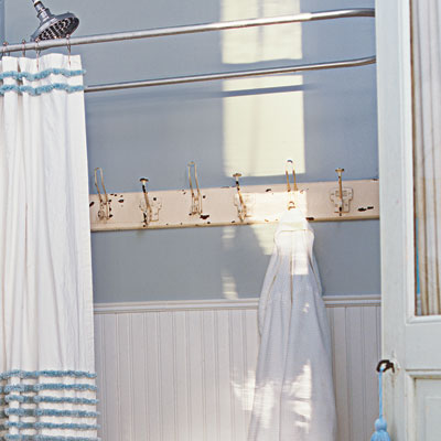 salvaged towel rack in bathroom