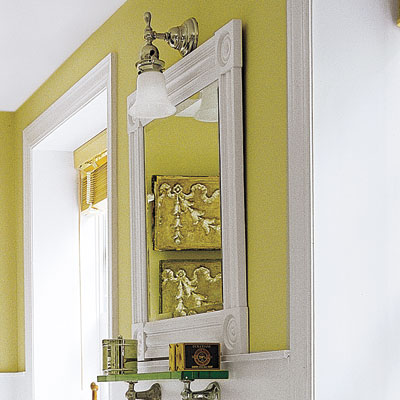 bathroom with framed mirror