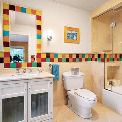bathroom with tile framed mirror