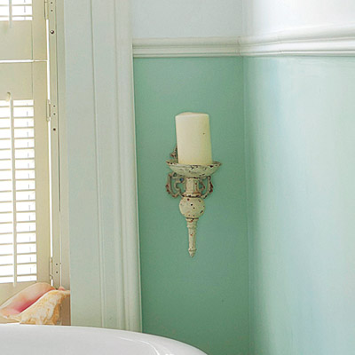 bathroom with faux candle lighting