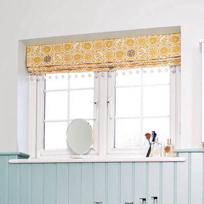 bathroom with roman shade window treatment