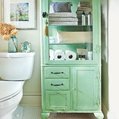 bathroom with vintage dental supply cabinet