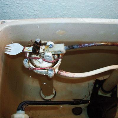 spork used to repair a toilet tank