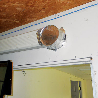 ductwork made from a downspout and a food can