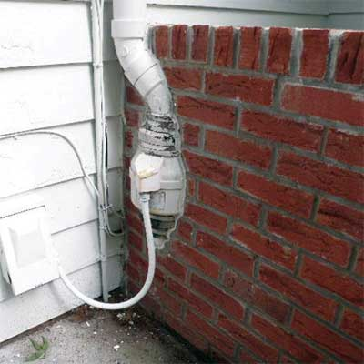 external fan built into a brick and mortar wall