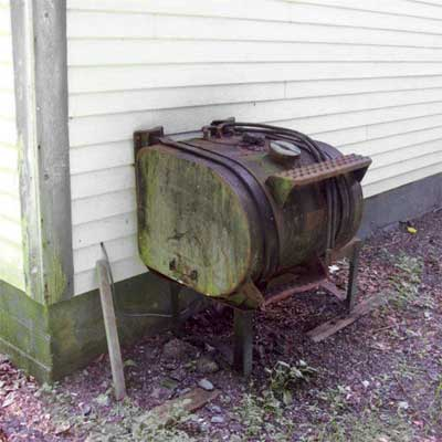 truck tank converted to an exterior oil tank for a garage furnace