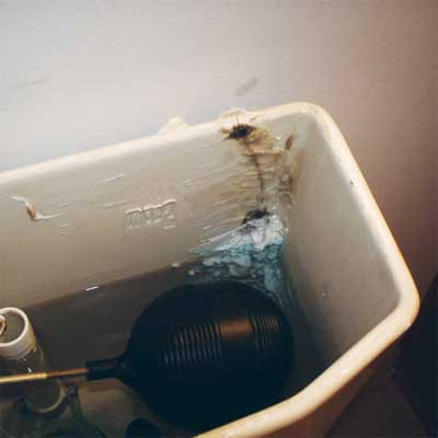 caulk used to repair a crack in a water-filled toilet tank