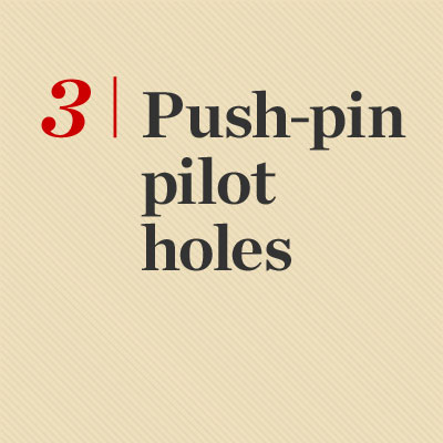 making pilot holes with push pins reader tip to save time and money