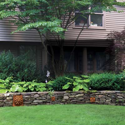 stone wall separating garden and lawn with terra cotta accents, easy upgrade