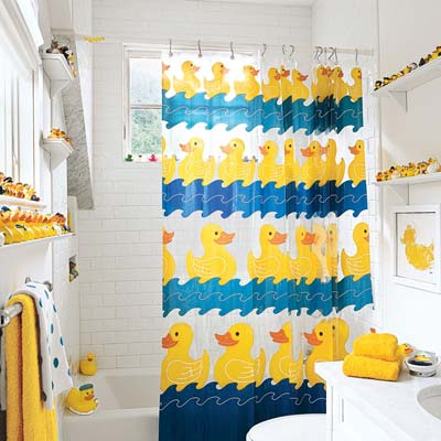bathroom with rubber ducky shower curtain and shelves of rubber ducks