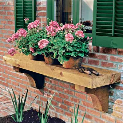 potted plant shelf on exterior of brick house