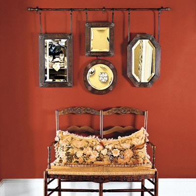 antique mirrors hung on a rod as wall art