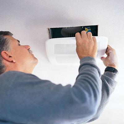 tom silva installing a bathroom vent fan