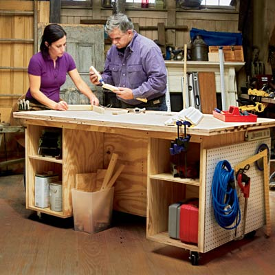 Tom Silva standing at diy built tool bench