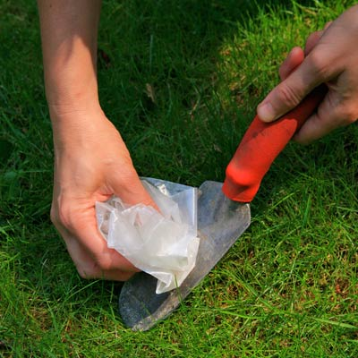 cleaning a garden tool with wax paper
