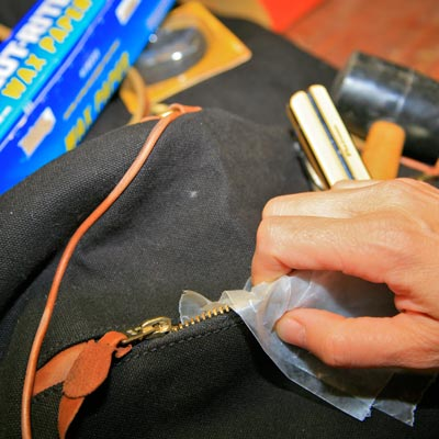 freeing a stuck tool bag zipper with wax paper
