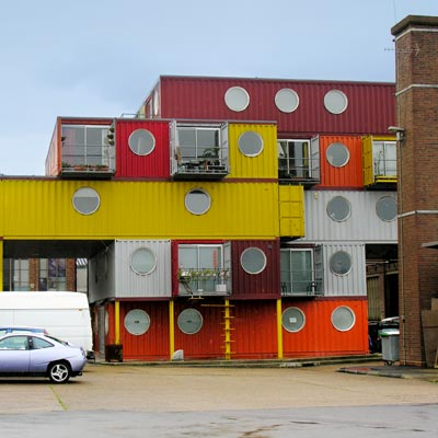 a housing complex built from recycled freight shipping containers