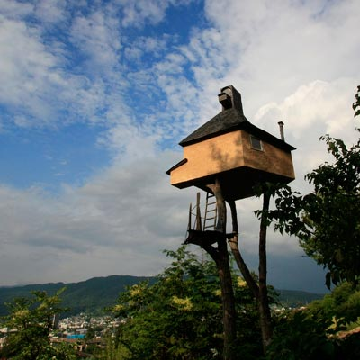 a traditional Japanese teahouse on stilts