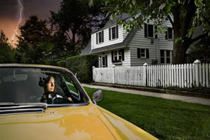 woman driving away from ominous house