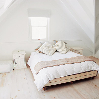All-white attic bedroom