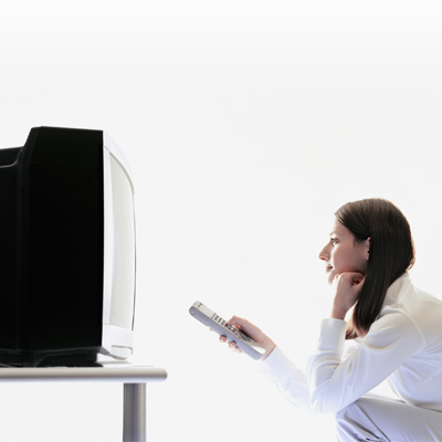 Woman watching a box television