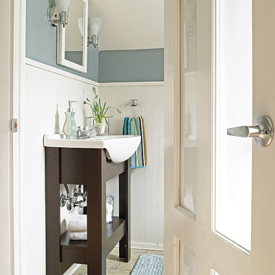 remodeled bathroom with glass paneled door