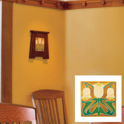a Craftsman-style art tile on a dining room wall