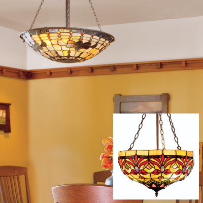 a Tiffany-style pendant light fixture hanging from a dining room ceiling