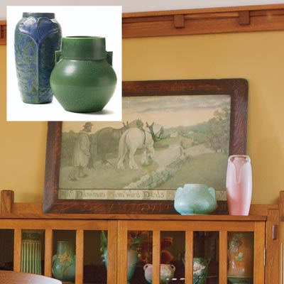 vintage-style pottery on top of a china cabinet in a dining room