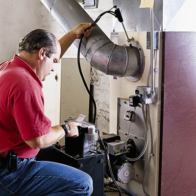 Richard Trethewey checks a furnace