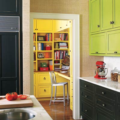 kitchen with green cabinets and yellow working space