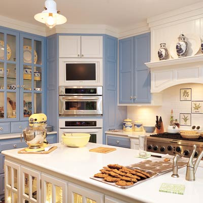 kitchen with periwinkle and white painted cabinets
