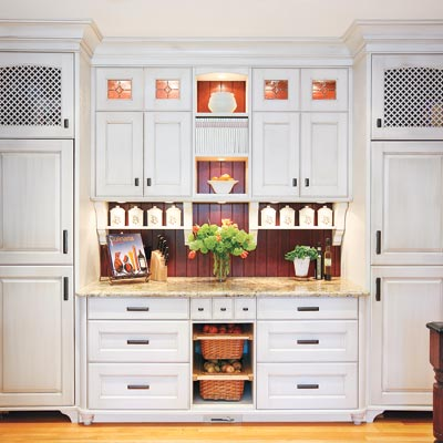 old world style kitchen with white cabinetry and cupboard refrigerators