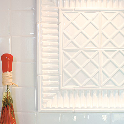 old world style kitchen with crackle glazed tile backsplash