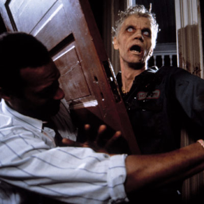 night of the living dead scene with zombie breaking through front door