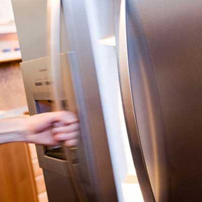 man opening refrigerator hurricane irene storm prep